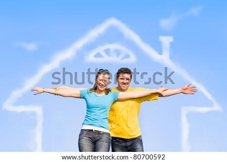 spouses enjoy life outdoors, spread their arms - stock photo