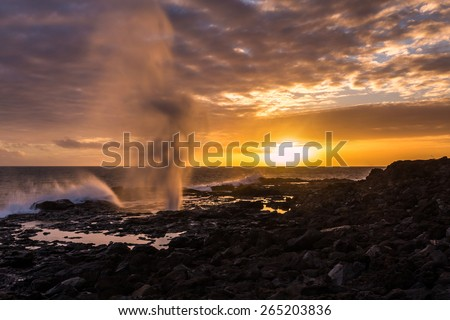 Spouting Horn Sunset, Kauai - stock photo