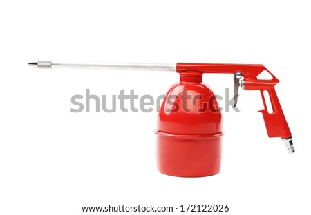 Spray gun of red color. Isolated on a white background. - stock photo
