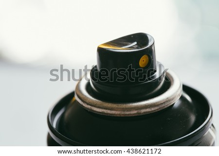 Spray with plastic pipe on blurred background . - stock photo