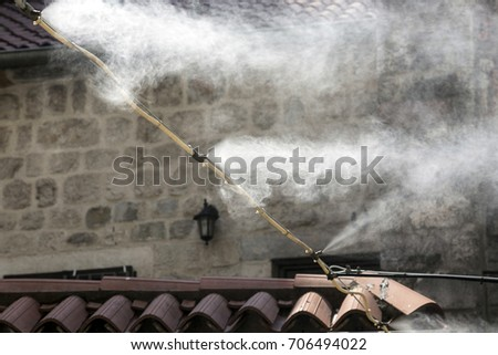 Spraying water with a fog formation system