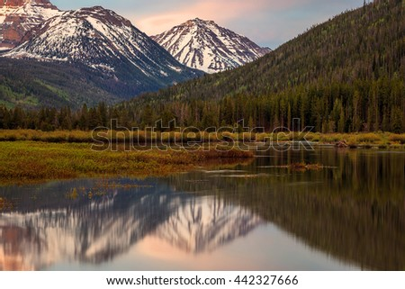 Spread Eagle Peak reflecting in the Bear River, Uinta Mountains, Utah, USA. - stock photo