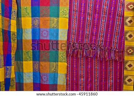 Spread Mayan textiles showing traditional pattern, design and color from Chiapas, Mexico - stock photo