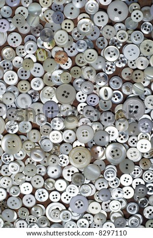Spread of assorted, predominantly white, dressmaking buttons