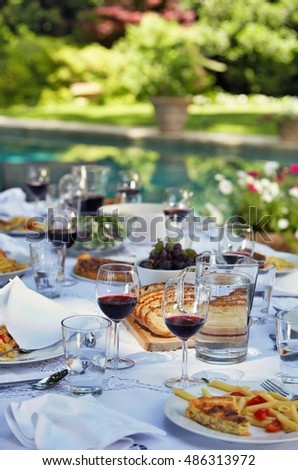 Spread of Food on a Table Outdoors