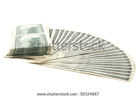 Spread of hundred dollar bills on a white background