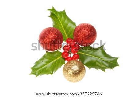 Sprig of Holly with Christmas baubles isolated against white - stock photo