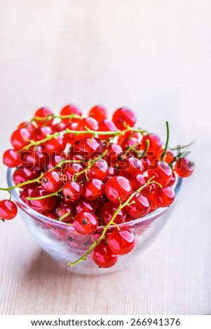 Sprigs of red currant on table.