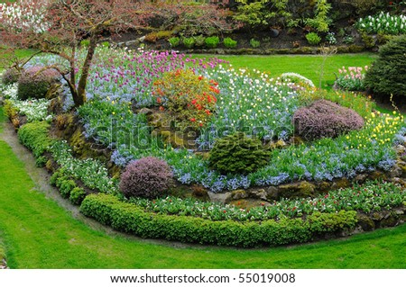 spring beautiful butchart gardens, victoria, british columbia, canada - stock photo