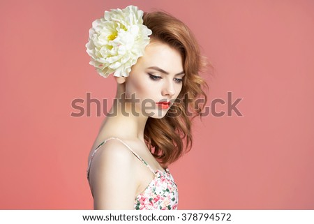 spring beautiful lovely girl with flower in hair. beauty young woman over pink background - stock photo