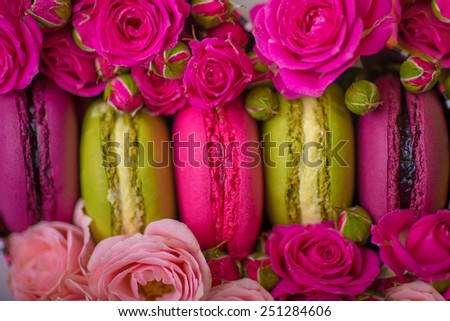 spring berry color macaroons with roses background for valentines mother day easter with love - stock photo