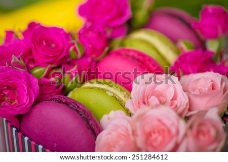spring berry pink color macaroons with roses background for valentines mother day easter with love food - stock photo