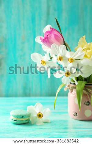Spring bouquet in vase on color wooden background - stock photo