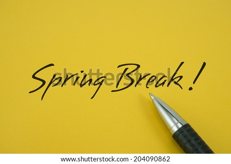Spring Break! note with pen on yellow background
