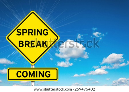 Spring break sign yellow road sign with clouds and sky in background  - stock photo