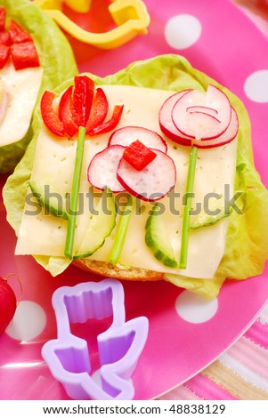 spring breakfast for child with  flowers on sandwich - stock photo