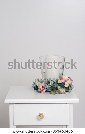 spring candle holder on table - stock photo