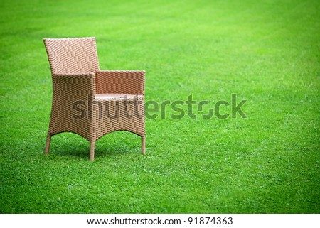 Spring chair in the middle of the  fresh lawn