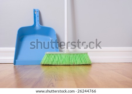 Spring Cleaning broom against wall - stock photo