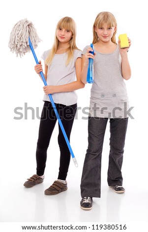 Spring cleaning - teen girls with cleaning utensils - stock photo