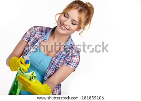 Spring cleaning woman pointing cleaning spray bottle. - stock photo