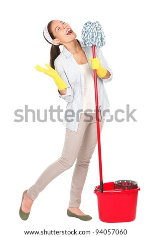 Spring cleaning woman singing fun using mop isolated on white background. Mixed race Caucasian and Asian young housewife having fun doing chores with cleaning mop and bucket for floor washing. - stock photo