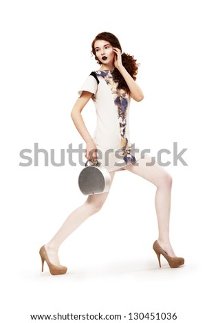 Spring Collection. Fashion Woman with Handbag wears Modern Dress. Holiday - stock photo