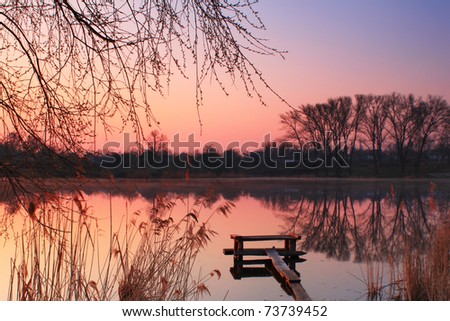 Spring Dawn on a small lake - stock photo