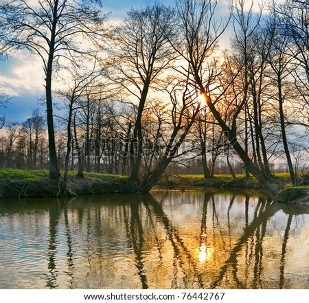 Spring evening at the river - stock photo
