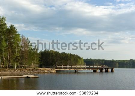 Spring evening Saimaa lake with pier. Imatra. Finland - stock photo