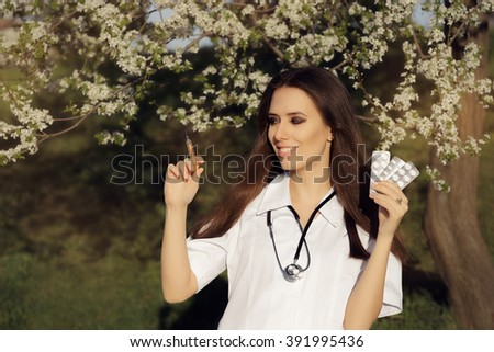 Spring Female Doctor with  Vaccine Syringe and Pills - Allergist  holding  immunization vaccine and antihistaminic pills   - stock photo