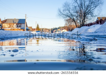 Spring flooding in the village - stock photo