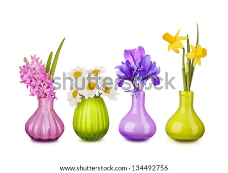 Spring flowers in vases isolated on white background - stock photo