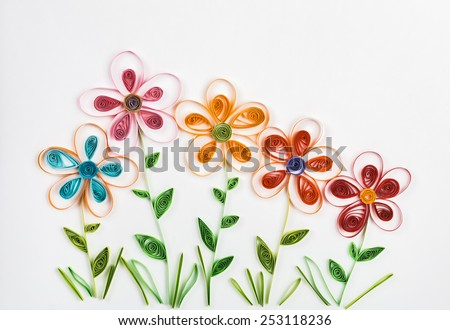 spring flowers made quilling on a light background - stock photo