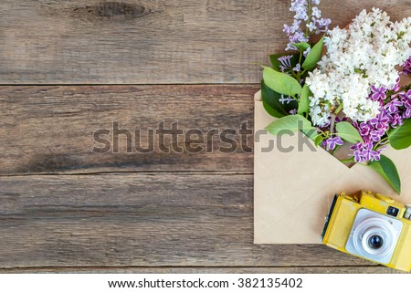 Spring flowers. March 8th, mother's day, valentine's day, International Women's Day, congratulate, camera is painted in yellow by me - stock photo