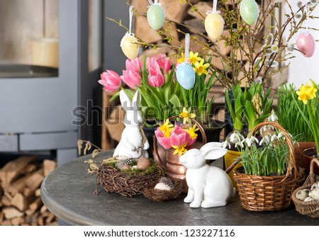 spring flowers with easter eggs decoration. tulips, snowdrops and narcissus blooms on white background. selective focus - stock photo
