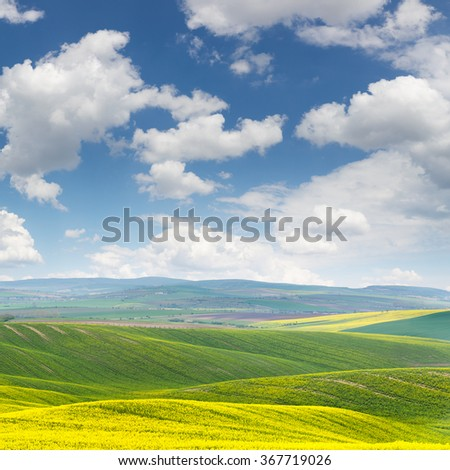 Spring fresh landscape of colorful fields and beautiful hills with blue sky - big size