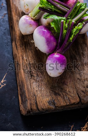 Spring fresh young purple turnip, on wooden rustic chopping board - stock photo