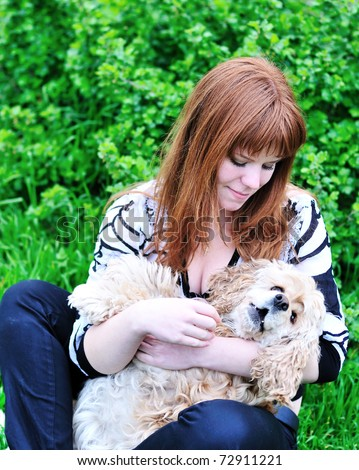 spring fun of redheaded girl and her dog - stock photo