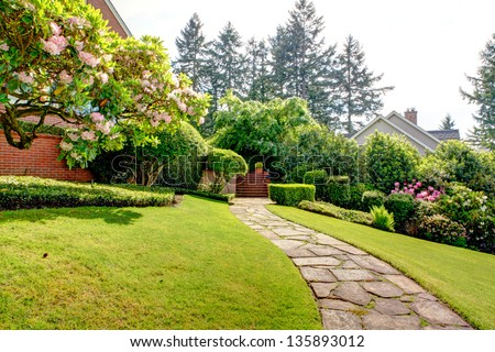 Spring garden and pathway near home. American Northwest. End of May. - stock photo