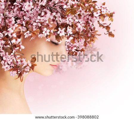 Spring Girl. Beautiful Woman with Cherry Blossom in her hair