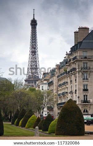 Spring in Paris. Street with a view to Eiffel Tower with dramatic sky. France