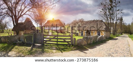 Spring in the National Museum of Architecture in Pirogovo, where a rich collection of ancient wooden and stone temples, houses, outbuildings including an abundance of gardens and flowers - stock photo