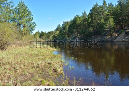 Spring in the national Park. Spring landscape, the river and the first greens in the trees.