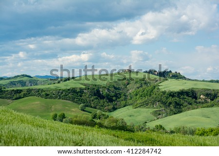 Spring in Tuscany on siena create with valleys and green hills and cypress
