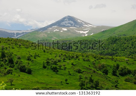 Spring landscape with snowy mountains, Pambak range, Maymekh Lerr (3094m) - stock photo