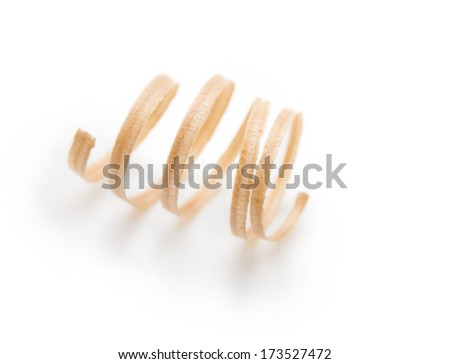 Spring like wood shavings isolated on white. Shallow depth of field.  - stock photo