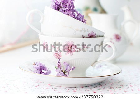 Spring lilacs in a teacup romantic still life - stock photo