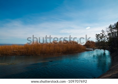 Spring natural landscape on the gulf near the river - stock photo