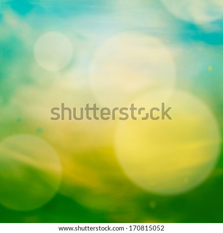 Spring or summer abstract nature background with meadow and blue sky in the back - stock photo